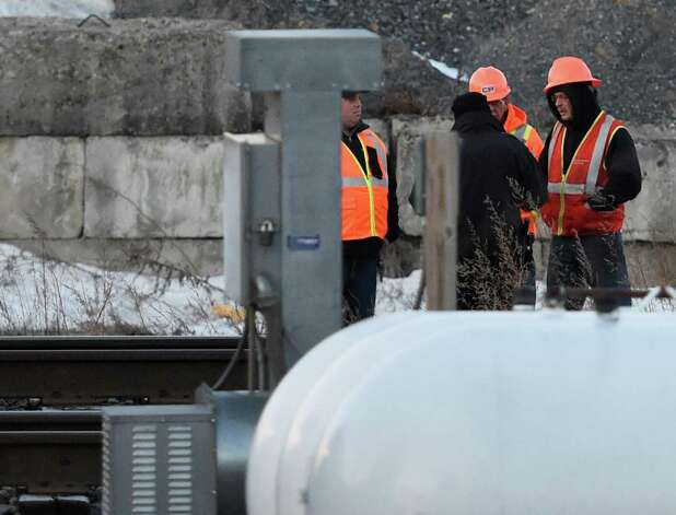 Investigators begin the task of determining how a man was killed Wednesday morning, March 25, 2015, on the railroad tracks near Sheehan St. in Mechanicville, N.Y. (Skip Dickstein/Times Union) Photo: SKIP DICKSTEIN
