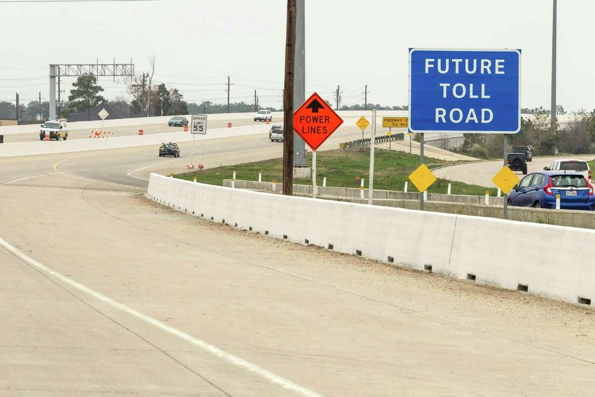 """A """"Future Toll Road"""" sign stands alongside Texas 249 as construction continued on the Tomball Tollway in February."""