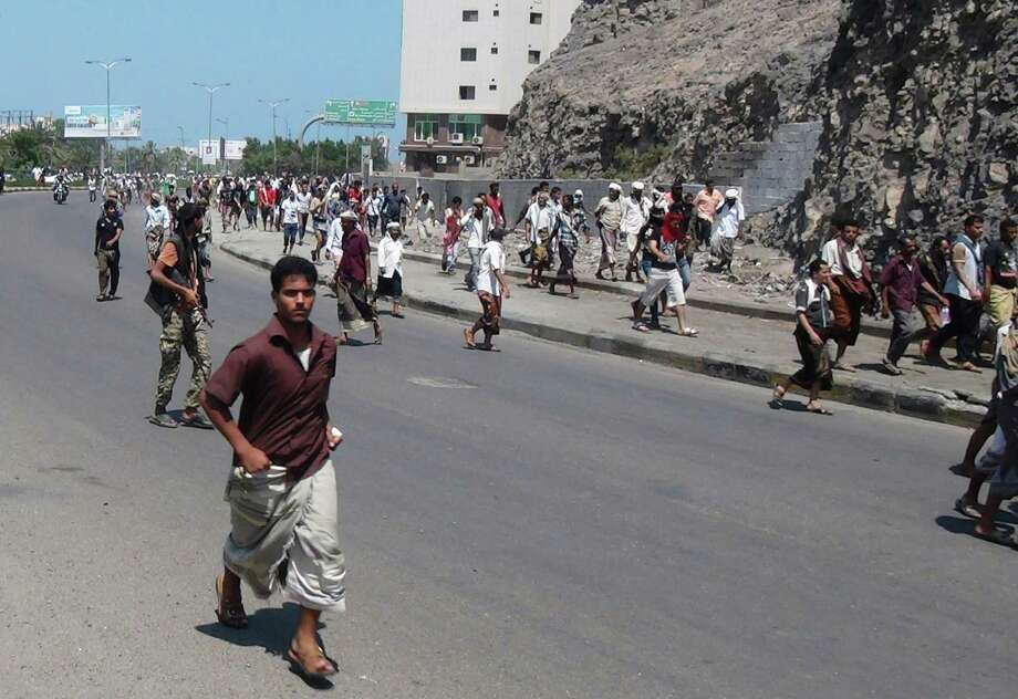 People flee gunfire in the southern port of Aden. The crumbling of President Abed Rabu Mansour Hadi's government is a blow to Washington's counterterrorism strategy against al Qaeda's branch in Yemen. Photo: Yassir Hassan / Associated Press / AP