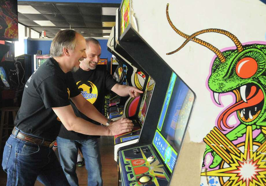 Co-owner Daniel Caswell. of Cypress, watches his business partner Rusty Key a vintage video game at the Game Preserve, a family friendly arcade, at 473 Sawdust Road. Over 90 vintage arcade games are available for play. Photograph by David Hopper Photo: David Hopper, Freelance / freelance