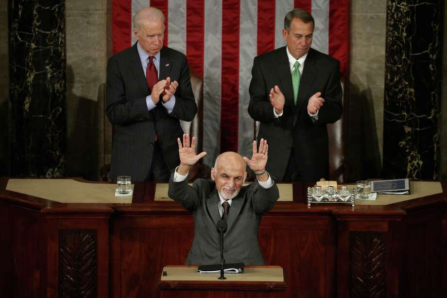 Afghanistan President Ashraf Ghani expresses his country's gratitude for America's fiscal commitment and military sacrifices during an address to a joint meeting of the United States Congress with Vice President Joe Biden (left) and Speaker of the House John Boehner in the House Chamber of the U.S. Capitol. Photo: Chip Somodevilla / Getty Images / 2015 Getty Images