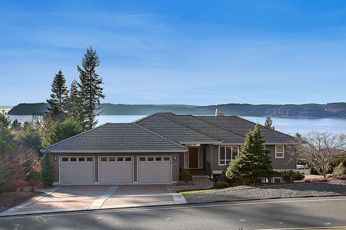 This home, located at 8602 54th Place W. in Mukilteo, offers sweeping views of Puget Sound. It has five bedrooms, three-and-a-half bathrooms, not to mention an indoor multi-sport court, recreation room, exercise area and outdoor putting green. See the full listing here.