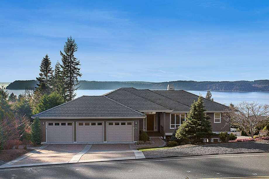 This home, located at 8602 54th Place W. in Mukilteo, offers sweeping views of Puget Sound. It has five bedrooms, three-and-a-half bathrooms, not to mention an indoor multi-sport court, recreation room, exercise area and outdoor putting green. See the full listing here. Photo: Redfin