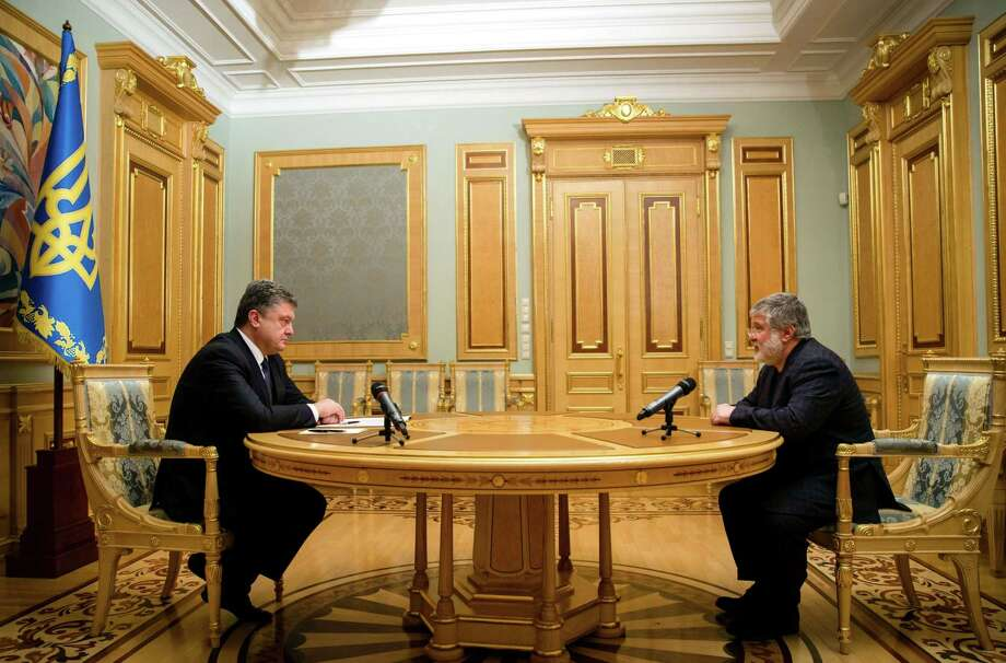 Ukraine President Petro Poroshenko, left, talks with the Governor of Dnipropetrovsk region Igor Kolomoisky. Poroshenko dismissed Kolomoisk, one of the country's most controversial tycoons, from his regional governor's post, his office said. Photo: MICHAIL PALINCHAK / AFP / Getty Images / Mikhail Palinchak