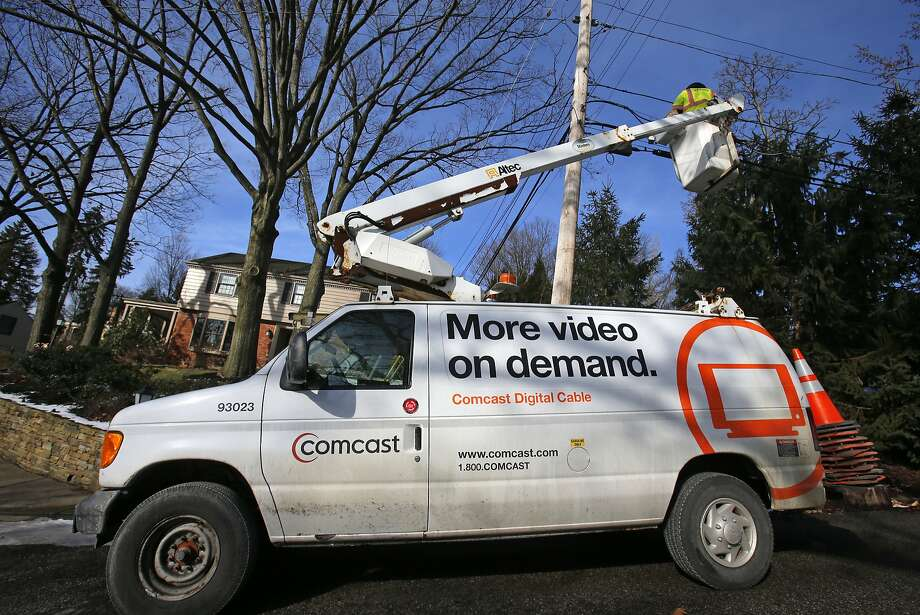 In this Thursday, Jan. 9, 2014 file photo, a Comcast cable truck works in front of a home in Mount Lebanon, Pa. Comcast is adding more social media representatives as it tries to work on its reputation for inefficient, unresponsive or just plain rude customer service, the company announced Monday, March 23, 2015. Photo: Gene J. Puskar, Associated Press