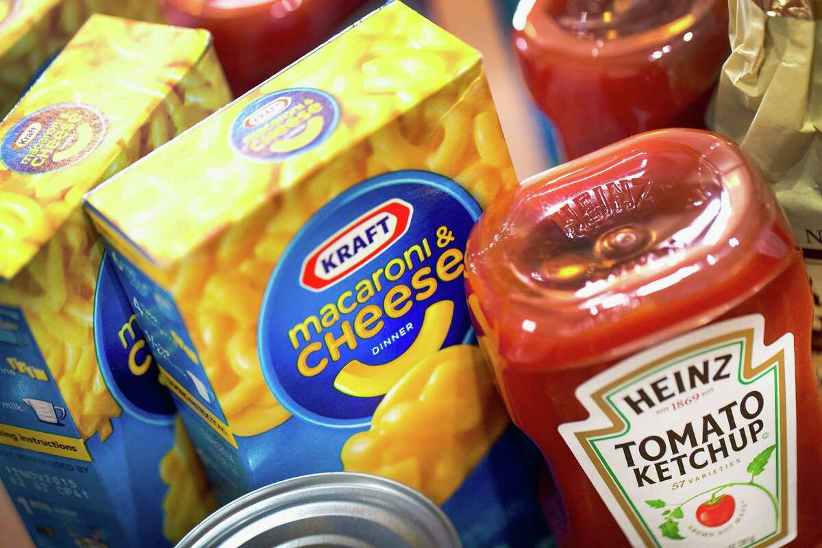 CHICAGO, IL - MARCH 25: In this photo illustration, Kraft and Heinz products are shown on March 25, 2015 in Chicago, Illinois. Kraft Foods Group Inc. said it will merge with H.J. Heinz Co. to form the third largest food and beverage company in North America with revenue of about $28 billion. (Photo Illustration by Scott Olson/Getty Images)