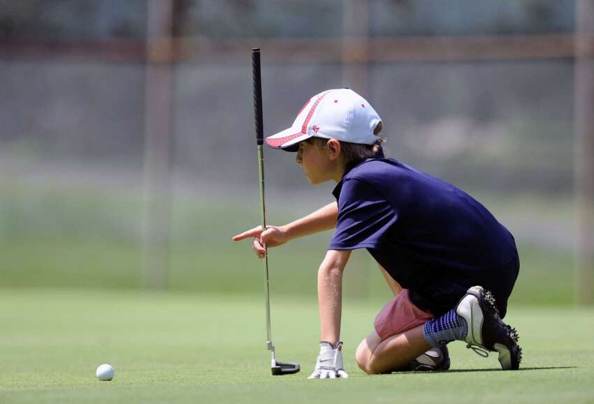 Griffith E. Harris Golf Course - Greenwich Pictured: Brad Skowron, 10, lines up his putt on the first green during the Town of Greenwich Junior Golf Championship at the Griffith E. Harris Golf Course in Greenwich, Conn., Wednesday, July 30, 2014.
