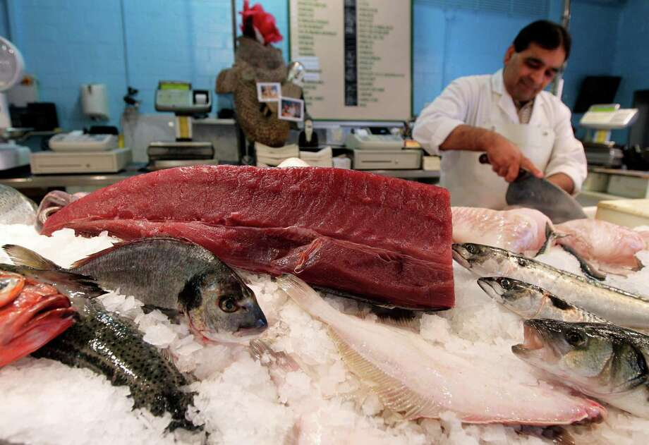 Yellowfin tuna caught in the Atlantic waters is displayed at a fish shop in Ghent, Belgium. Photo: Yves Logghe / Associated Press / AP
