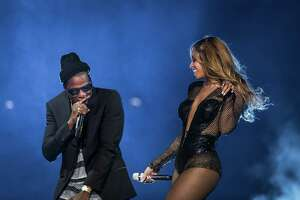 """FILE a€"""" Jay Z and Beyonce perform during opening night of their a€œOn the Runa€ tour at Sun Life Stadium in Miami Gardens, Fla., June 25, 2014. The show qualified as a few hours of very public marriage counseling following tabloid intrigue for the couple a few weeks before the stadium-tour opener. (Chad Batka/The New York Times) ORG XMIT: MER2015032515072017"""