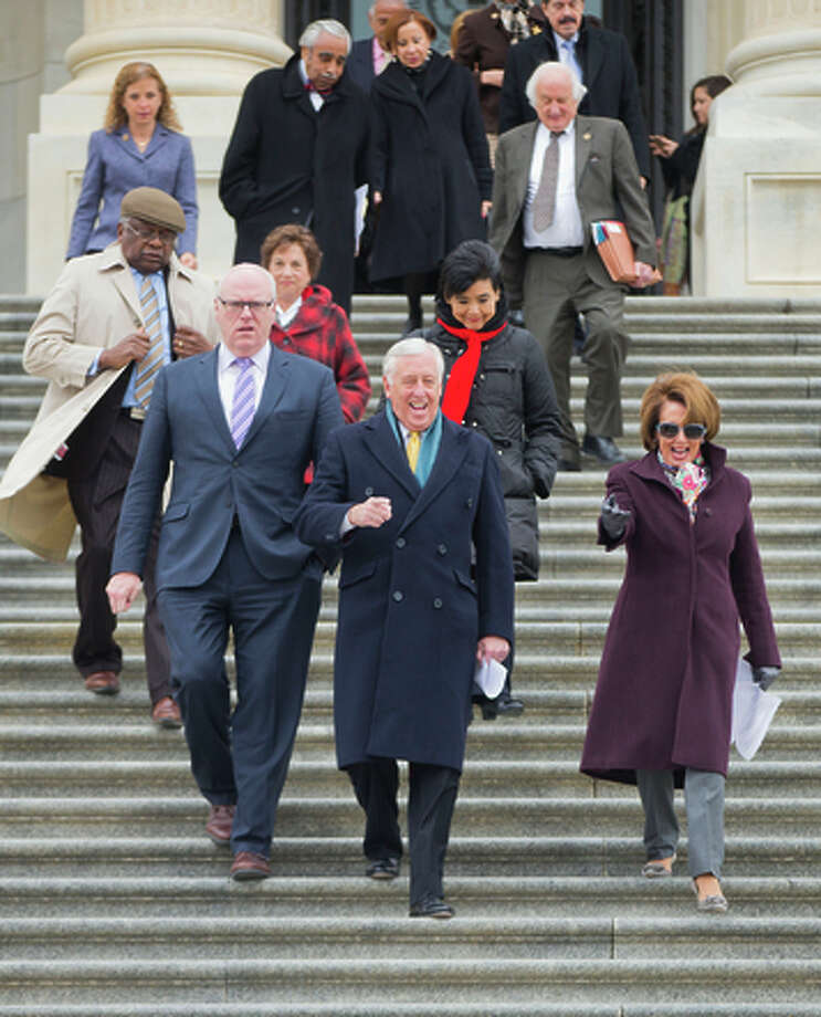 From right to left, House Minority Leader Nancy Pelosi of Calif., House Minority Whip Steny Hoyer of Md., Rep. Joseph Crowley, D-N.Y., House Assistant Minority Leader James Clyburn of S.C., and others, walk out together for an event on Capitol Hill in Washington, Tuesday, March 24, 2015, to commemorate the fifth anniversary of President Obama signing into law the Affordable Care Act. (AP Photo/Pablo Martinez Monsivais) Photo: Pablo Martinez Monsivais / Associated Press / AP