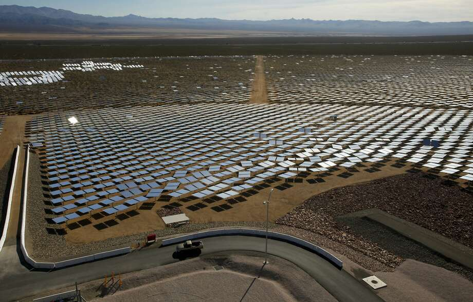 At the Ivanpah Solar Electric Generating System in California's Mojave Desert, some of the plant's 347,000 garage-door-sized mirrors used to generate power can be seen. California is looking for a reliable way to store green energy for when customers need it. (Mark Boster/Los Angeles Times/TNS) Photo: Mark Boster, McClatchy-Tribune News Service