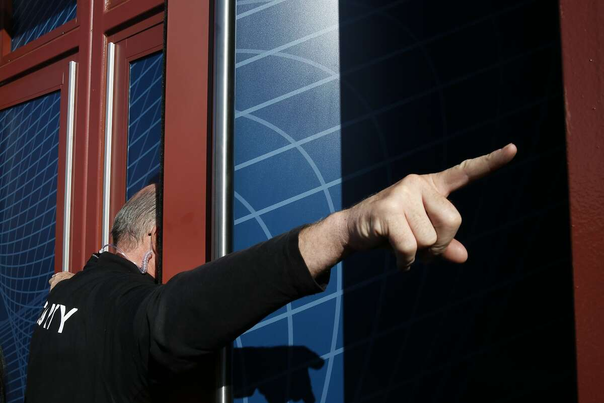 Lee, a Facebook security guard, gives directions to someone inside the Herbst building before Facebook CEO Mark Zuckerberg's keynote speech in the building during the first day of the F8 Facebook Developer Conference at the Fort Mason Center March 25, 2015 in San Francisco, Calif. Facebook CEO Mark Zuckerberg unveiled its Messenger Platform among other announcements.