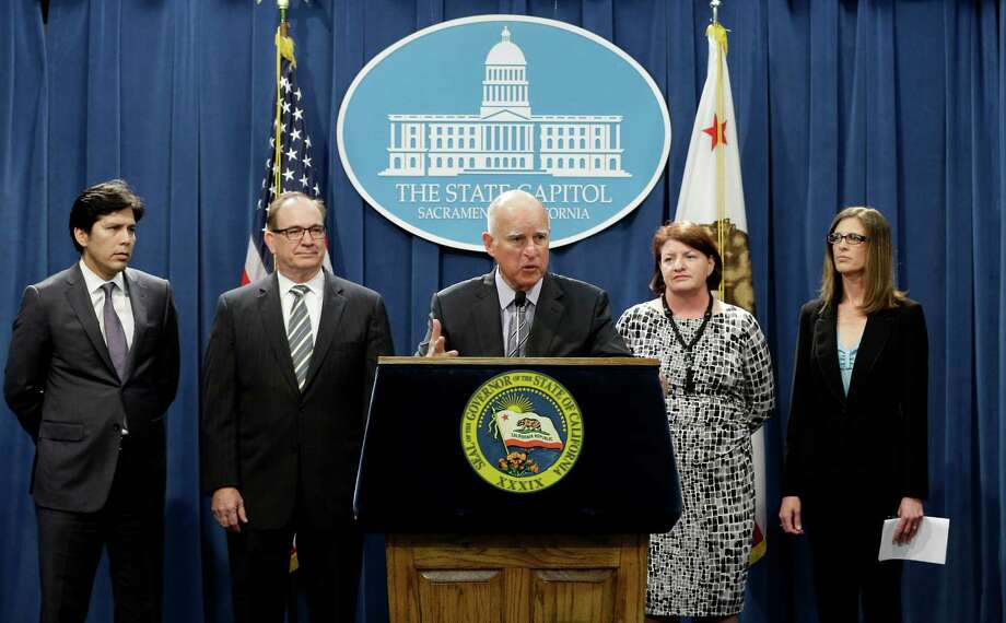 Gov. Jerry Brown joins legislative leaders to discuss his proposed emergency drought-relief legislation this month at the Capitol in Sacramento. Photo: Rich Pedroncelli / Associated Press / AP