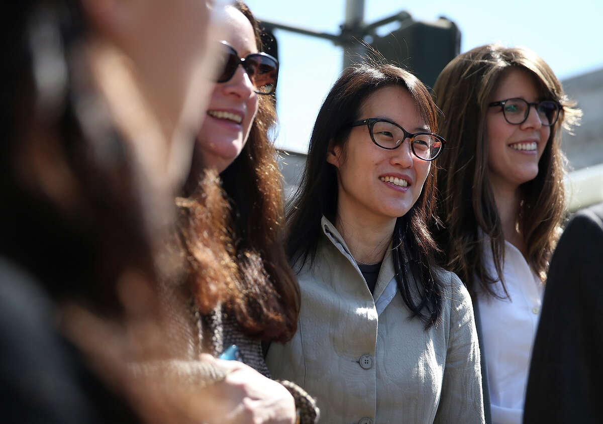 Ellen Pao (center) leaves San Francisco Superior Court with her legal team during a lunch break from her trial.