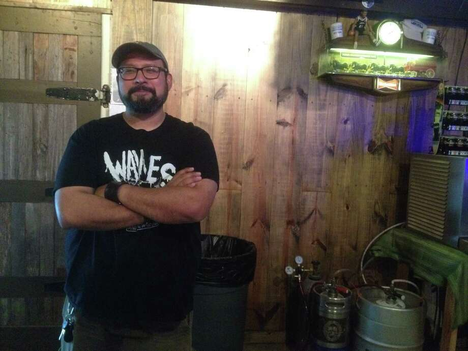 Steven Rodriguez owns the Beer Depot, a craft beer bar located on the near South Side inside a more than 100-year-old building that once housed a soap company, produce terminal, beer business and Tejano bar. Photo: Valentino Lucio /San Antonio Express-News