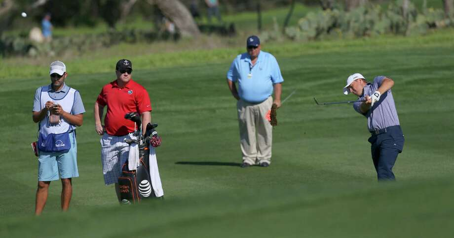 Jordan Spieth, right, hits a fairway shot Wednesday, Match 25, 2015 during the Valero Texas Open Pro/Am tournament in advance of the first round of official play on Thursday. Spieth is coming off of a win at last week's Valspar Championship. Photo: William Luther, Staff / San Antonio Express-News / © 2015 San Antonio Express-News