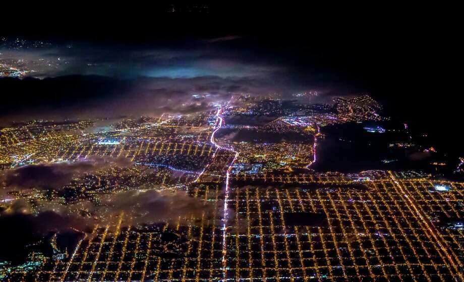 """The Bay Area at night is partially obscured by clouds in an image from photographer Vincent Laforet's """"Air."""" Photo: Vincent Laforet / Courtesy LAFORET VISUALS Inc. / ONLINE_CHECK"""