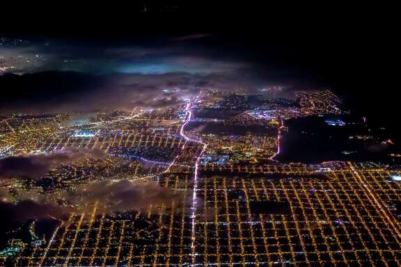 "The Bay Area at night is partially obscured by clouds in an image from photographer Vincent Laforet's ""Air."""