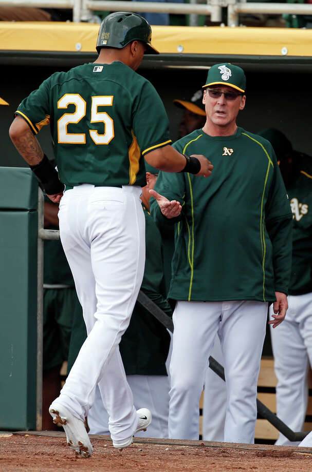 Tyler Ladendorf (25) is congratulated by manager Bob Melvin after scoring on a wild pitch. Photo: Scott Strazzante / The Chronicle / ONLINE_YES