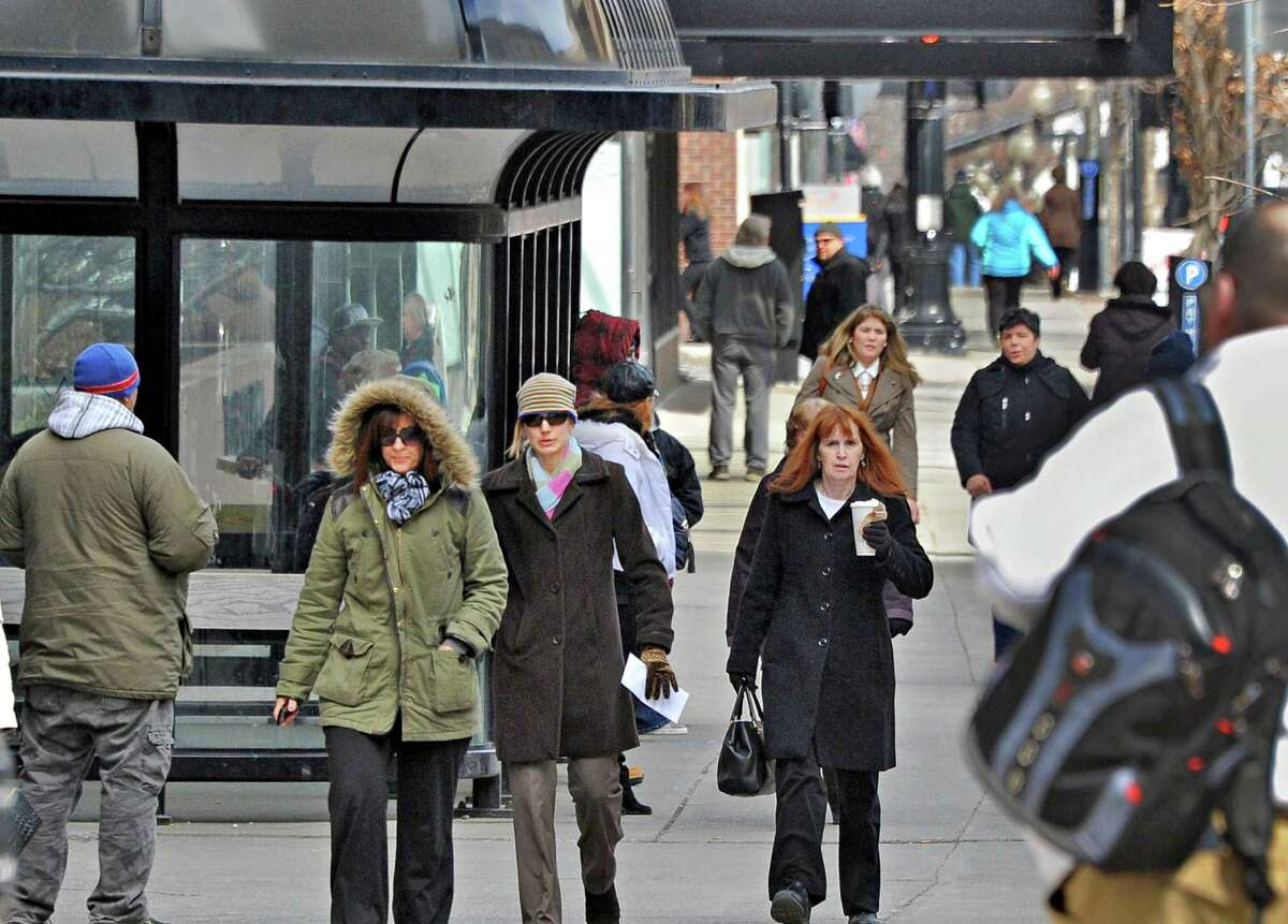 Pedestrians cross State Street at Pearl Street Tuesday March 24, 2015, in Albany, NY. (John Carl D'Annibale / Times Union)