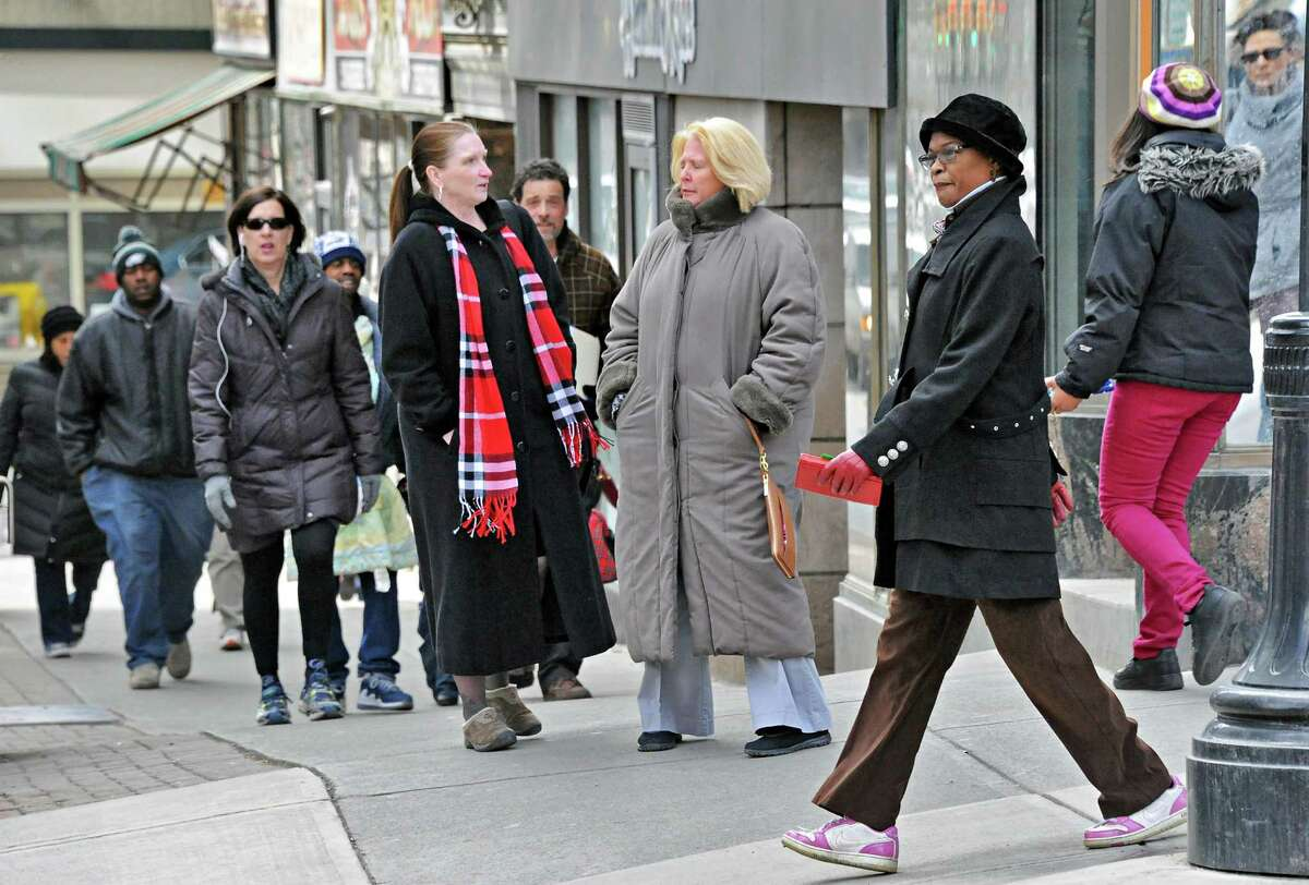 Pedestrians at the corner of State and Pearl Streets Tuesday March 24, 2015, in Albany, NY. (John Carl D'Annibale / Times Union)