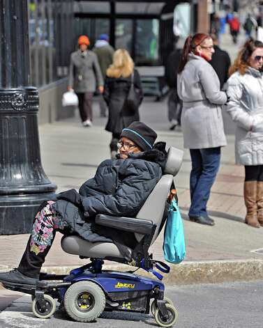 Pedestrians at the corner of State and Pearl Streets Tuesday March 24, 2015, in Albany, NY.  (John Carl D'Annibale / Times Union) Photo: John Carl D'Annibale / 00031161A