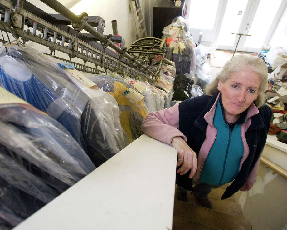 Michele Coppolo of SNS Cleaners in Stamford, Conn., talks about her experience being forced to leave her former location on Hope Street and move to her current location on East Main Street. Photo: Lindsay Perry / Stamford Advocate