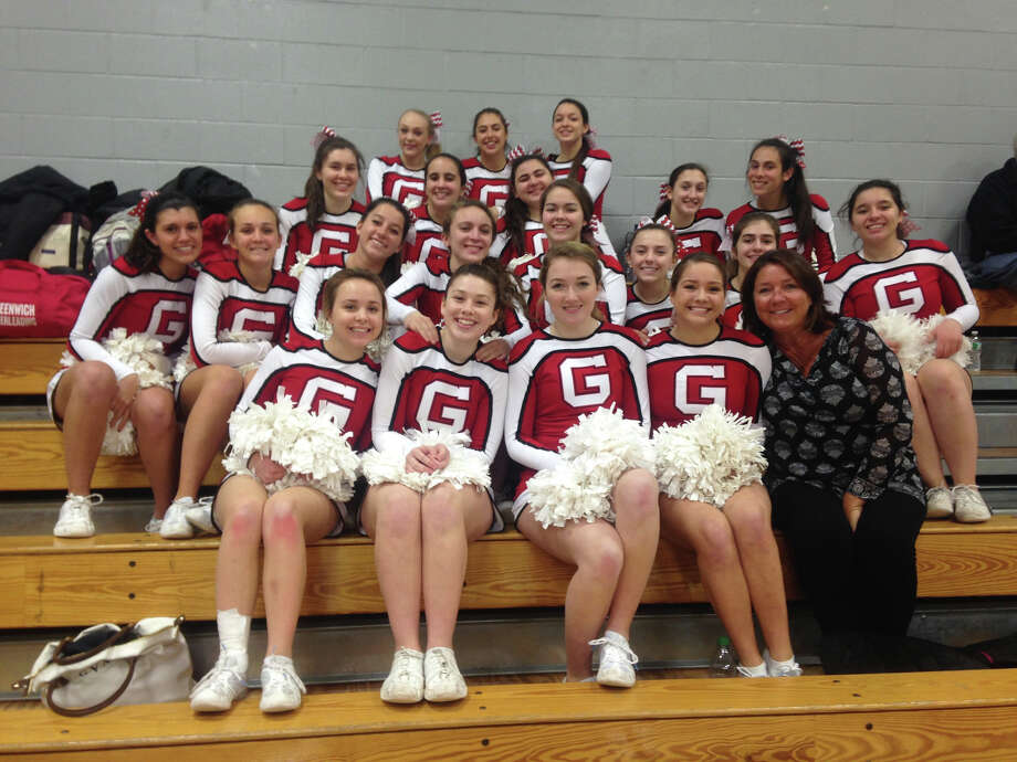 Mary Anne Catalano, front row, far right, gathers with her 2014-15 Greenwich High School cheerleading team. Catalano recently announced her retirement after being with the cheerleading program at GHS since 2000. Photo: Contributed Photo / Greenwich Time Contributed