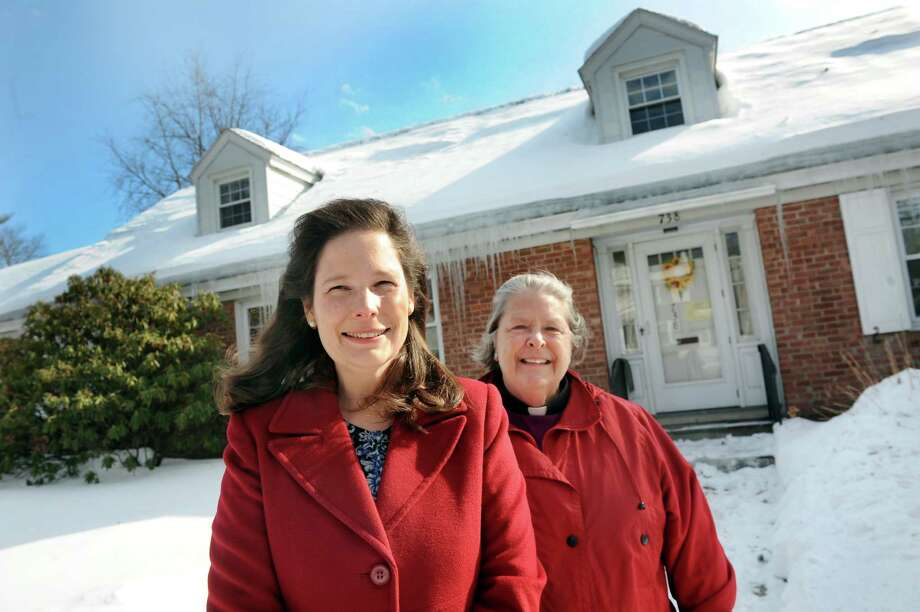 Mary Giordano, executive director of Family Promise of the Capital Region, left, and Rev. Peggy Funderburke on Wednesday, Feb. 25, 2015, at Bethany Reformed Church in Albany, N.Y. They want to run a program for the homeless out of the house on the property. (Cindy Schultz / Times Union) ORG XMIT: MER2015022516153033 Photo: Cindy Schultz / 00030755A
