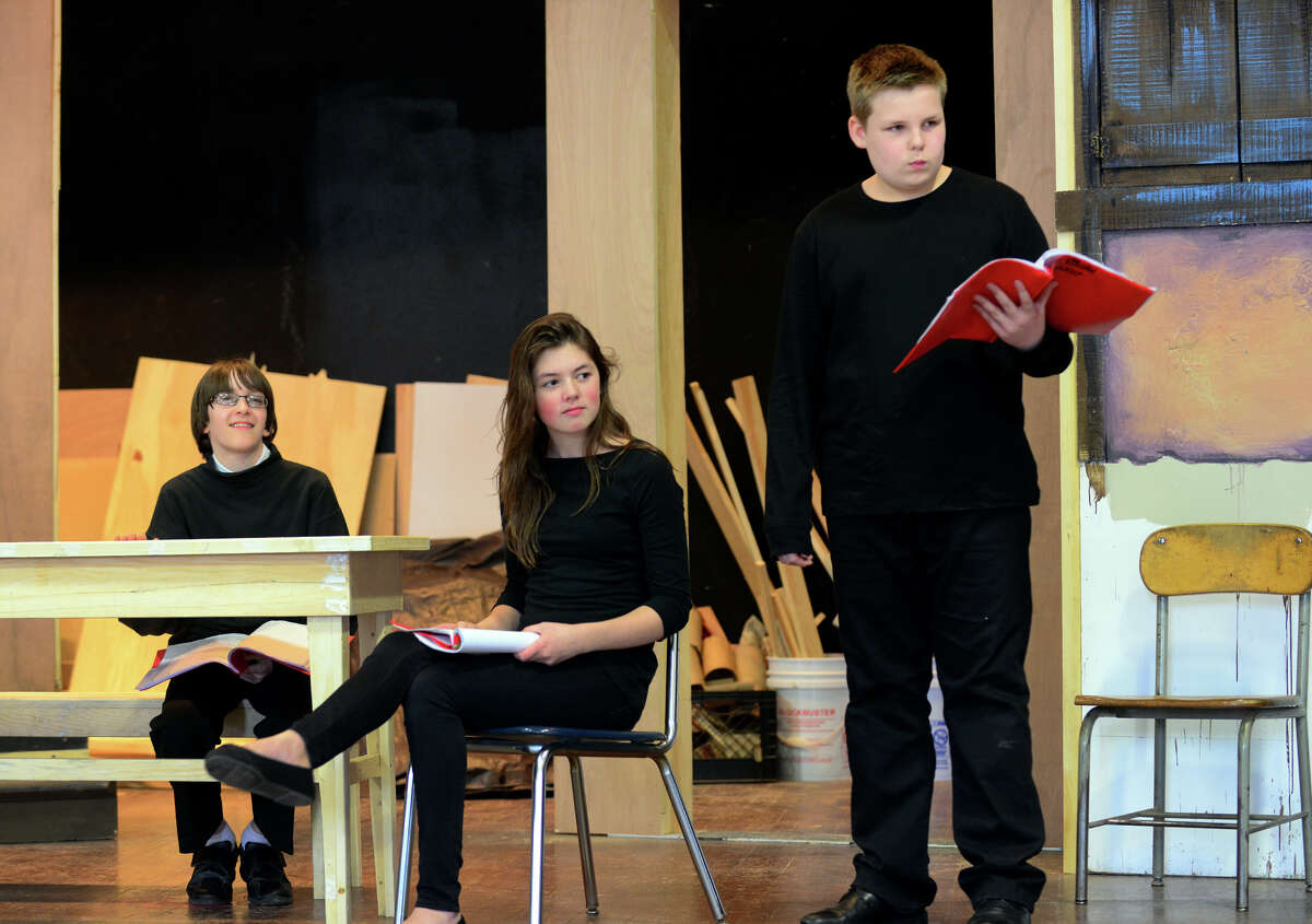 Students from St. James School rehearse for an upcoming production of Shakespeare's Taming of the Shew on the school's gymnasium stage in Stratford, Conn. on Wednesday Mar. 25, 2015. From left to right are students Andrzej Wieciorkowski, 12, Bianca Espejo, 13, and Paul Keegan, 13. The play will be performed on Saturday May 2nd at 7 p.m. and on Sunday May 3rd at 3 p.m. Tickets will be $5 at the door with no advance sales.