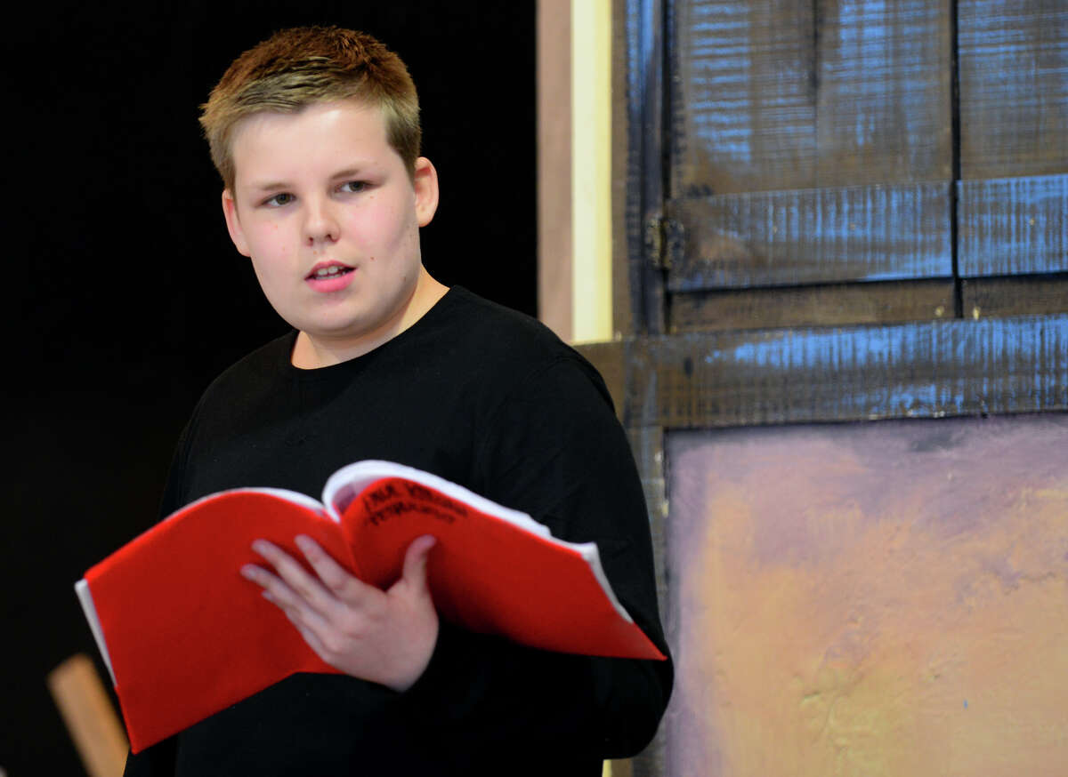 Student Paul Keegan, 13, from St. James School, rehearses for an upcoming production of Shakespeare's Taming of the Shew on the school's gymnasium stage in Stratford, Conn. on Wednesday Mar. 25, 2015. The play will be performed on Saturday May 2nd at 7 p.m. and on Sunday May 3rd at 3 p.m. Tickets will be $5 at the door with no advance sales.