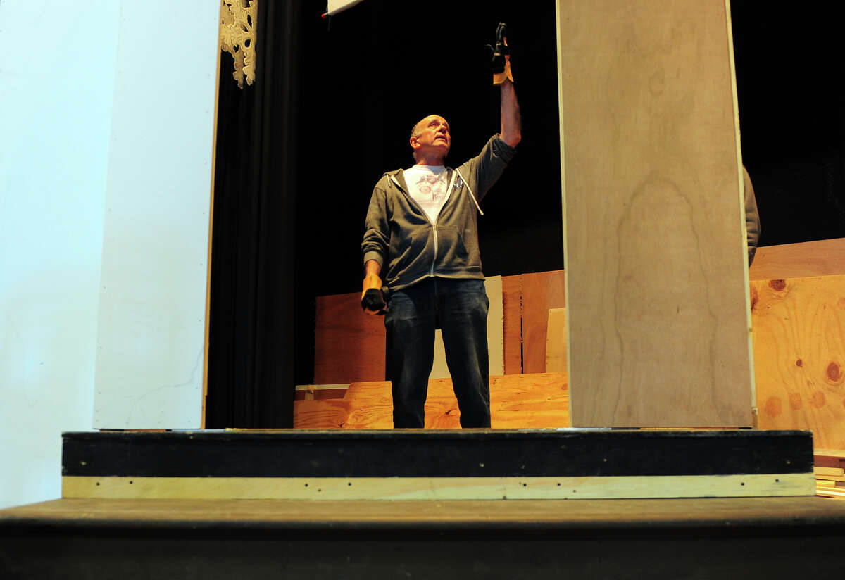 Director Dean Kyburz oversees construction of the set for the St. James School's upcoming production of Shakespeare's Taming of the Shew on the school's gymnasium stage in Stratford, Conn. on Tuesday Mar. 24, 2015. The play will be performed on Saturday May 2nd at 7 p.m. and on Sunday May 3rd at 3 p.m.