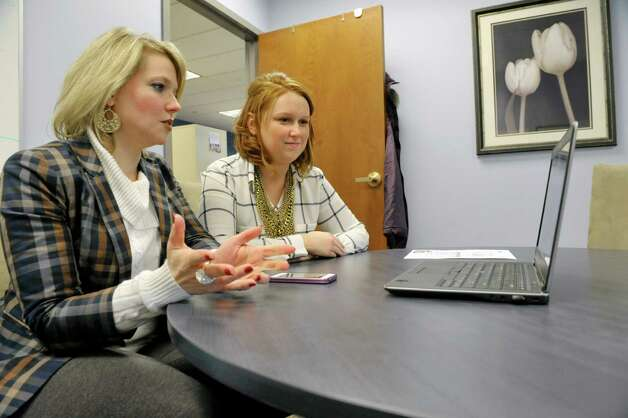 Miriam Dushane, left, managing director at Linium Staffing and Erin Gordon, a talent acquisition manager at Linium Staffing, talk with Karen Casper over a video technology the firm uses for interviewing on Thursday, Feb. 19, 2015, in Colonie, N.Y.     (Paul Buckowski / Times Union) Photo: PAUL BUCKOWSKI / 00030688A
