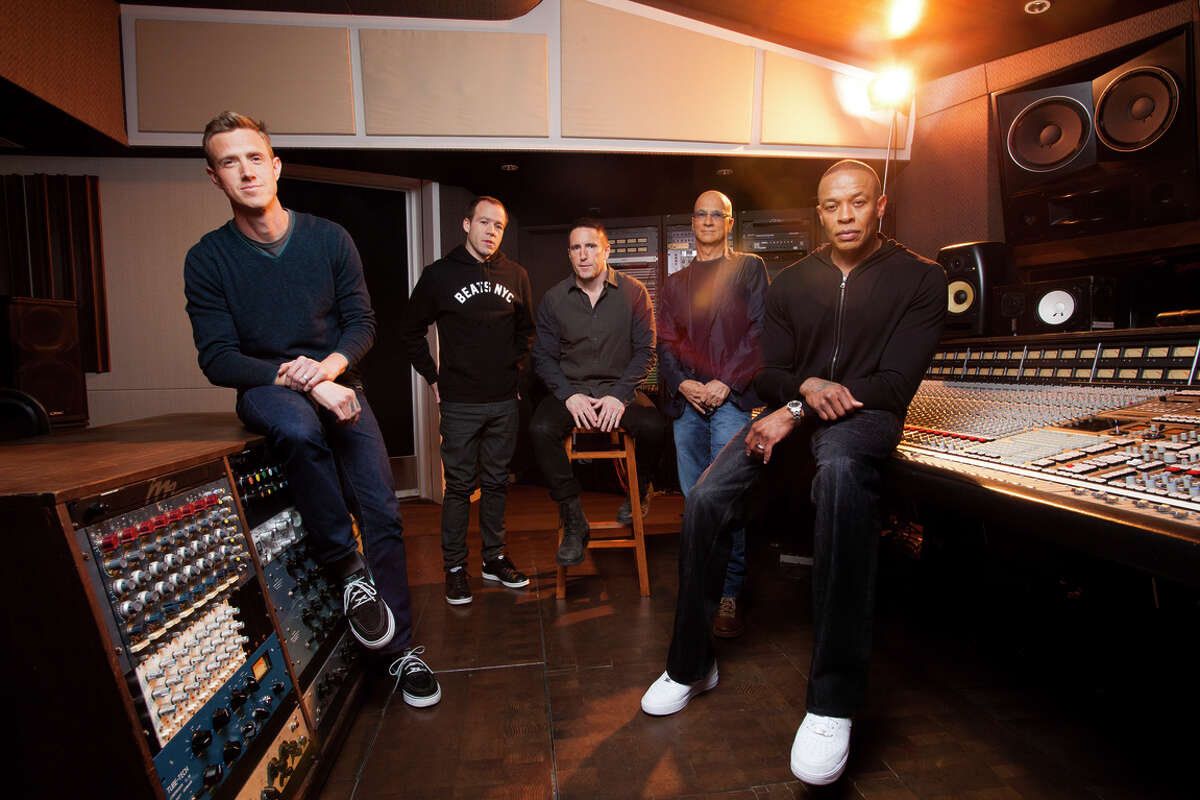 Beats executives in 2013: Ian Rogers, Luke Wood, Trent Reznor, Jimmy Iovine and Dr. Dre. Reznor will help Apple overhaul its music app to add streaming.