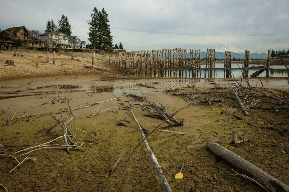 A train trestle that had been underwater for decades is shown on what was the bottom of Lake Tapps from a photo taken earlier this year. At that time the water level in the lake was beginning to rise after it was mostly drained earlier in the year for a maintenance project. The lake was created in 1911 as a Puget Sound Energy hydroelectric project. Since then it has become lined with waterfront homes and becomes a popular boating destination during warmer months. It is scheduled to reopen for some recreation on Saturday, June 19, 2015. Photo: JOSHUA TRUJILLO, SEATTLEPI.COM / SEATTLEPI.COM