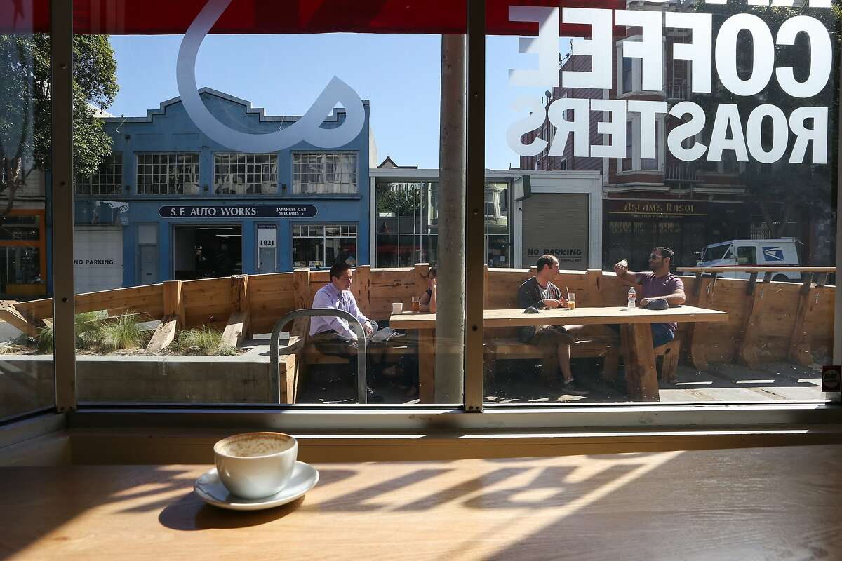 Many take advantage of the parklet at Ritual Coffee to enjoy the sun while drinking their coffee on Wednesday, March 25, 2015.