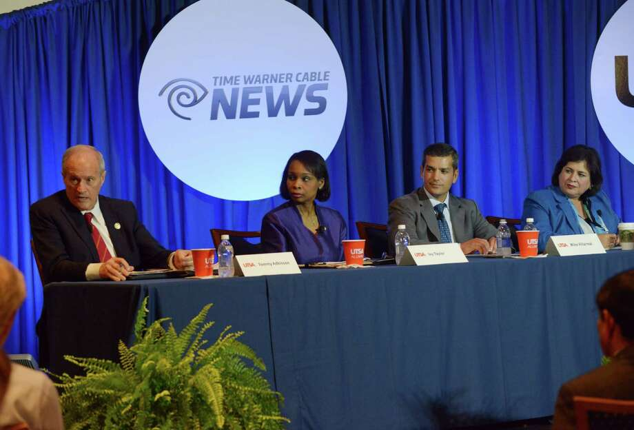 Former Bexar County Commissioner Tommy Adkisson, left, Mayor Ivy Taylor, former state Rep. Mike Villarreal and former State Sen. Leticia Van de Putte participate in a mayoral debate at UTSA on Wednesday, March 25, 2015. Photo: Billy Calzada, San Antonio Express-News /  San Antonio Express-News