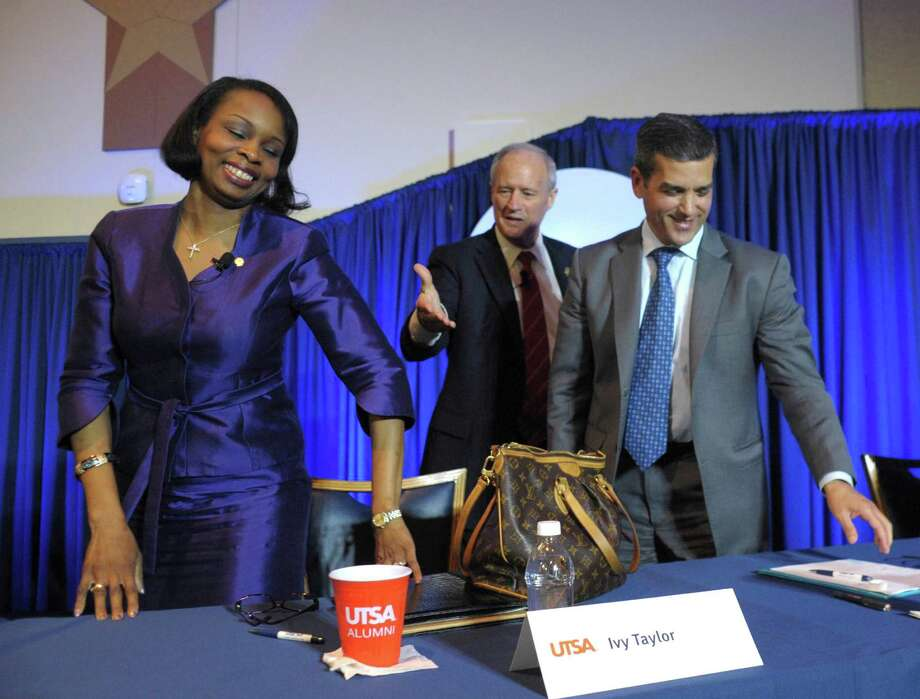 Former Bexar County Commissioner Tommy Adkisson, second from left, offers a handshake to Mayor Ivy Taylor as former state Rep. Mike Villarreal stands by after a mayoral debate at UTSA on Wednesday, March 25, 2015. Photo: Billy Calzada, San Antonio Express-News / San Antonio Express-News