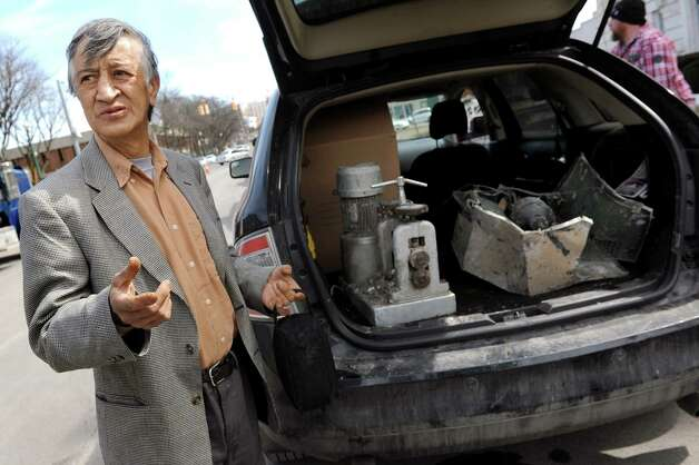 Benjamin Morales, owner of Esmeralda Jewelry, shows his destroyed jewelry-making machines on Wednesday, March 25, 2015, in Schenectady, N.Y. He estimates his losses total more than $90,000, and he has no insurance. (Cindy Schultz / Times Union) Photo: Cindy Schultz / 00031177A