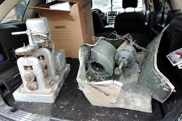 Destroyed jewelry-making machines, property of Benjamin Morales, owner of Esmeralda Jewelry, on Wednesday, March 25, 2015, in Schenectady, N.Y. Morales said the rolling machine, left, is the heart of the business. At right is the polishing machine. He estimates his losses total more than $90,000, and he has no insurance. (Cindy Schultz / Times Union) Photo: Cindy Schultz / 00031177A