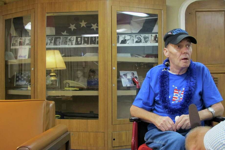 Joseph Hooker, a terminally ill Vietnam veteran, is interviewed inside the captain's cabin of the battleshi'p USS Missouri in Pearl Harbor, Hawaii, Wednesday, March 25, 2015. Joseph Hooker's longtime dream to visit Pearl Harbor has come true. The Dream Foundation arranged for the 63-year-old to travel from his home in Essex, Maryland, to Hawaii. (AP Photo/Jennifer Sinco Kelleher) Photo: Jennifer Sinco Kelleher / Associated Press / AP