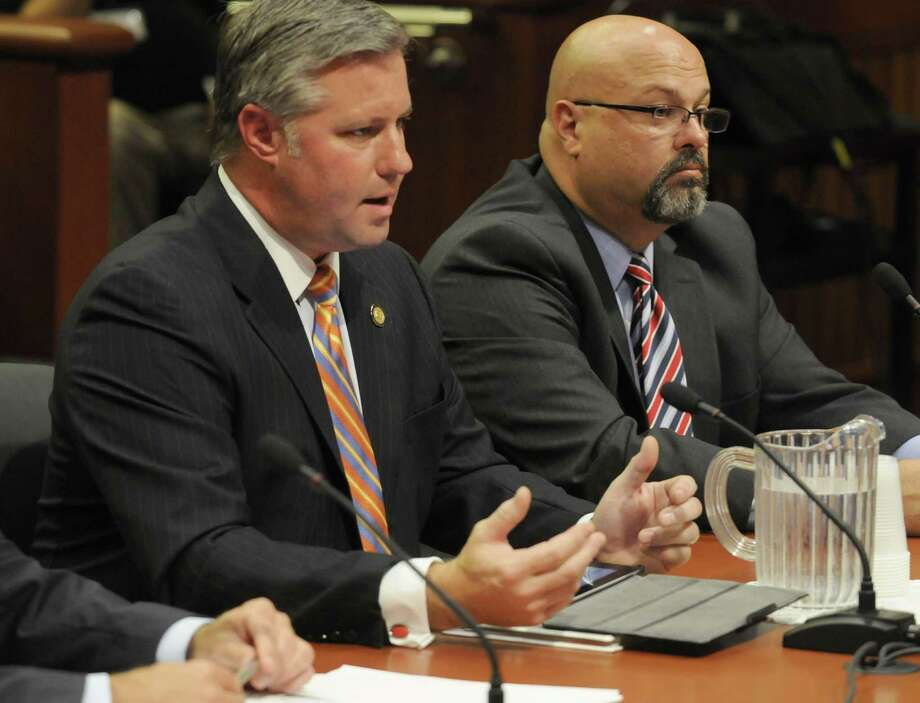 Thomas J. Madison Jr., executive director of the New York State Thruway Authority, center, and and chief financial officer, John Bryan, right, speak during an Assembly hearing on the finances and operations of the Thruway Authority Friday, Sept. 7, 2012, in Albany, N.Y. (Michael P. Farrell/Times Union archive) Photo: Michael P. Farrell / 00019176A