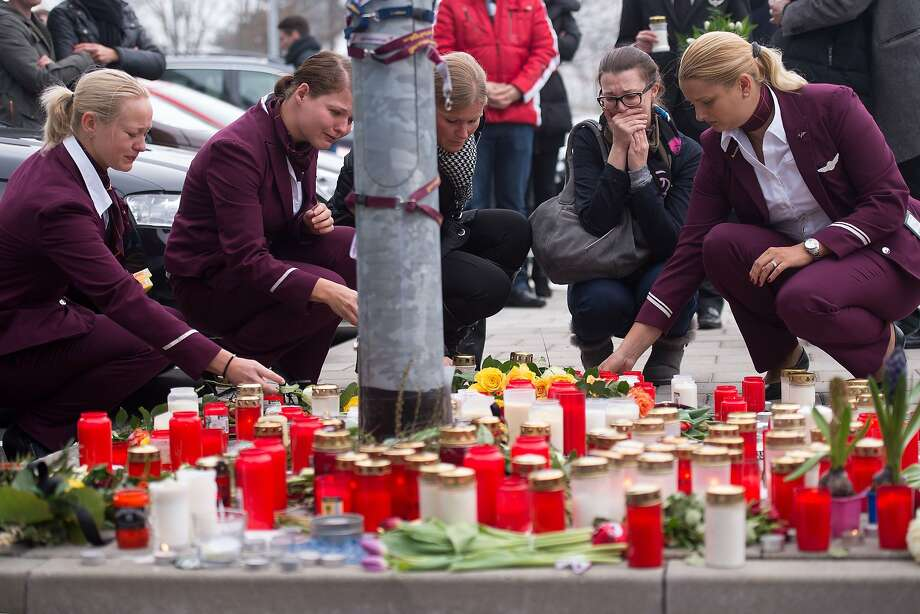 Employees of German airline Germanwings lay down candles and flowers for the victims of the Germanwings plane crash in front of the company's headquarters in Cologne, western Germany, on March 25, 2015 a day after after a Germanwings Airbus A320 coming from Barcelona and heading to Duesseldorf smashed into the French Alps, killing all 150 people on board. Photo: Marius Becker, AFP / Getty Images