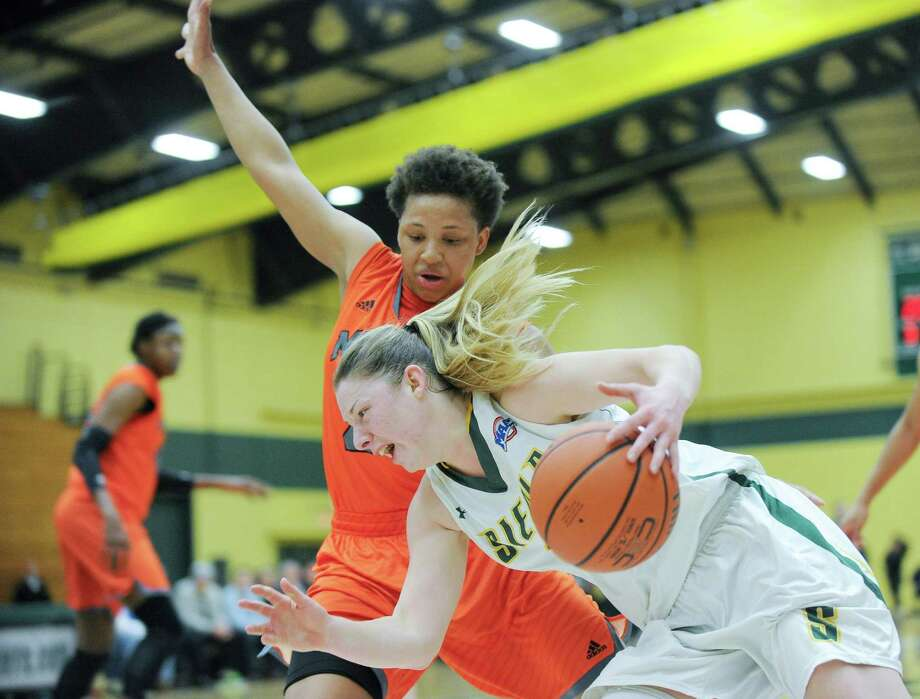 Siena's Ida Krogh (2) moves the ball against Mercer's Kahlia Lawrence (24) during the semifinal game of the Women's Basketball Invitational tournament in Loudonville, N.Y., Wednesday, March 25, 2015. (Hans Pennink / Special to the Times Union) ORG XMIT: HP101 Photo: Hans Pennink / Hans Pennink