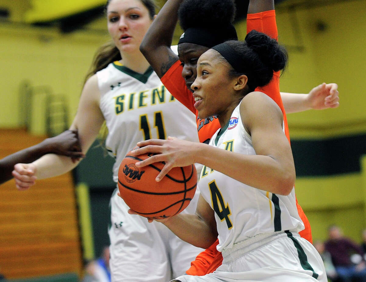 Siena's Emia Willingham (4) moves the ball against Mercer during the semifinal game of the Women's Basketball Invitational tournament in Loudonville, N.Y., Wednesday, March 25, 2015. (Hans Pennink / Special to the Times Union) ORG XMIT: HP102