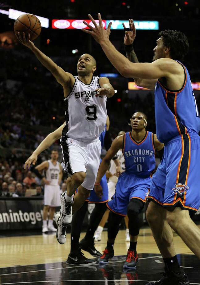 San Antonio Spurs' Tony Parker drives to the basket as Oklahoma City Thunder's Steven Adams defends during the first half at the AT&T Center, Wednesday, March 25, 2015. Photo: JERRY LARA, Staff / San Antonio Express-News / © 2015 San Antonio Express-News