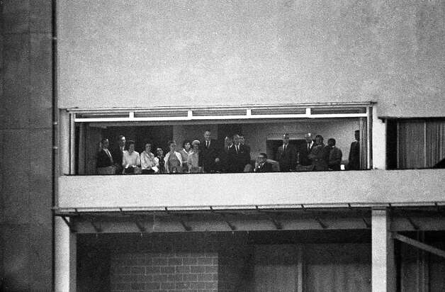 President Lyndon Johnson, Lady Bird Johnson and entourage join Roy Hofheinz in his suite to watch opening festivities at the Astrodome, April 9, 1965. Photo: Houston Post / Houston Chronicle