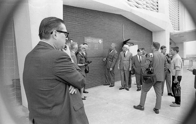 Roy Hofheinz, foreground left, and county officials outside the Astrodome, 1965. Photo: Houston Post / Houston Chronicle