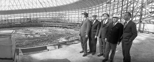 Officials, including Roy Hofheinz, center, National League President Warren Giles and astronaut Alan Shepard tour Astrodome, 1964. Photo: Houston Post / Houston Chronicle