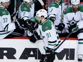 Tyler Seguin (center) celebrates his shootout goal that lifted the Stars over the Flames in Calgary, Alberta.